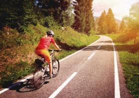 woman biking on a bikeway in wonderful nature